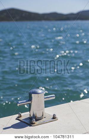 Metal bollard on the dock of pier