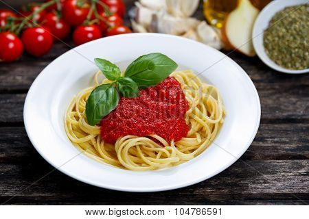 Spaghetti With Marinara Sauce And Basil Leaves On Top, Decorated With Vegetables, Olive Oil, Italian