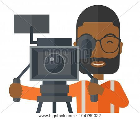 An african-american cameraman with beard and glasses looking through movie camera on a tripod vector flat design illustration isolated on white background. Horizontal layout.