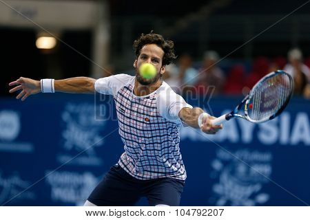 KUALA LUMPUR, MALAYSIA - OCTOBER 02, 2015: Spain's Feliciano Lopez eyes a forehand return in his match at the Malaysian Open 2015 tennis tournament held at the Putra Stadium, Malaysia.