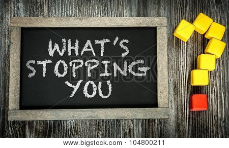 Whats Stopping You? written on chalkboard