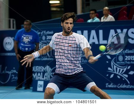 KUALA LUMPUR, MALAYSIA - OCTOBER 03, 2015: Spain's tennis player Feliciano Lopez plays a forehand return at the 2015 Malaysian Open tennis tournament from Sep 26 - Oct 4, 2015 in Stadium Putra.