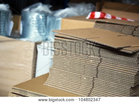 Unfolded Cardboards For Boxes In The Warehouse