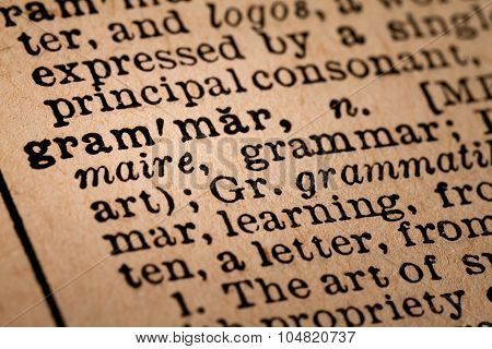 Close-up Of An Opened Dictionary Showing The Word Grammar
