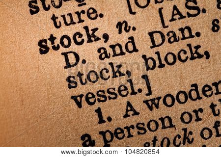 Close-up Of An Opened Dictionary Showing The Word Stock