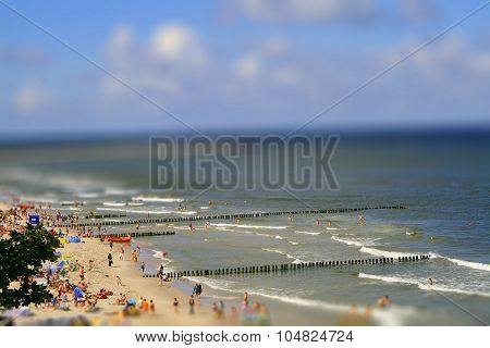 Beach At Sea In Summer With Holiday Makers