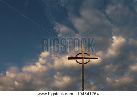 Christian cross with blue sky and clouds