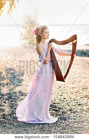 Portrait of beautiful woman with harp