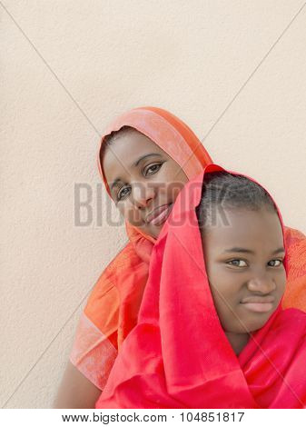 Rebel preteen in the arms of her mother