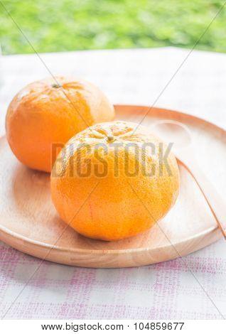 Fresh Honey Murcott On Wooden Plate