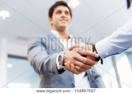 Handshake of businessmen greeting each other