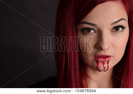 Vampire Woman With Blood On Her Face And Red Hair