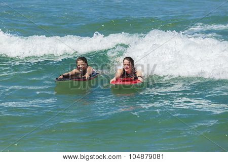 Girls Surfing Ocean Waves