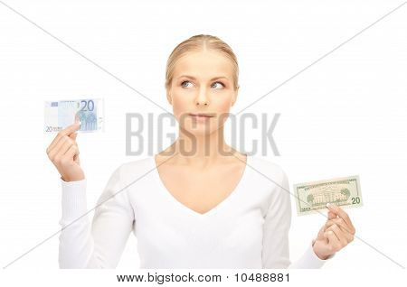 Woman With Euro And Dollar Money Notes