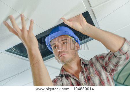 Builder replacing ceiling panel