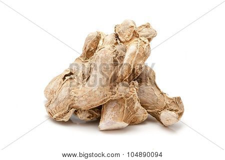 Pile of Organic Dried Ginger root.