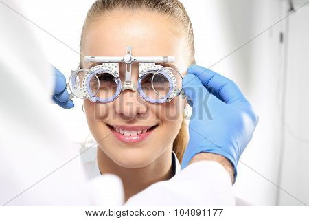 The patient at an ophthalmologist, selection of eyeglass