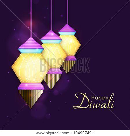 Colourful hanging illuminated lanterns or lamps on shiny purple background for Indian Festival of Lights, Happy Diwali celebration.