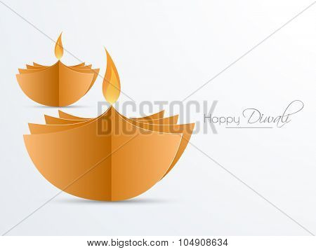 Creative illuminated lit lamps made by glossy papers for Indian Festival of Lights, Happy Diwali celebration.