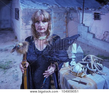 Serious Witch With Bird Fetishes
