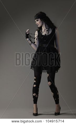 Rocker woman posing in edgy black outfit