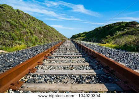 Rusty old railroad goes to horizon
