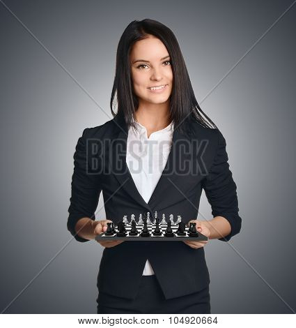 Business woman holding a chess urging to make the right move