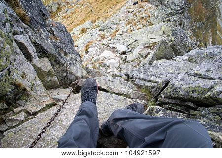 Photo of a man going down from Ostry Rohac peak at Tatra mountains, Slovakia. Nature photography. poster