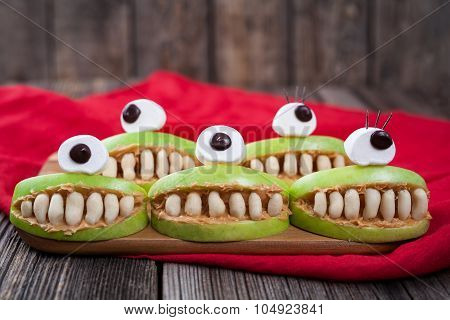 Cute scary halloween apple cyclop monsters food healthy vegetarian celebration party snack dessert r