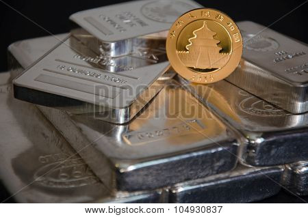 Chinese Gold Panda Coin On Silver Bars