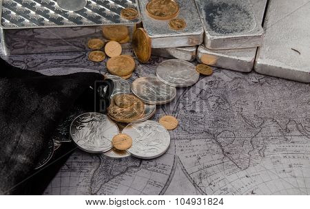 Silver Eagle Coins & Gold Eagle Coins With Silver Bars On Map