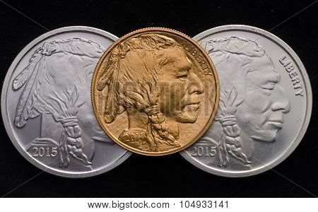 Us Gold Buffalo Ontop Of 2 Silver Buffalo Rounds