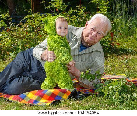 Little Boy Stays Near Grandfather Outdoor