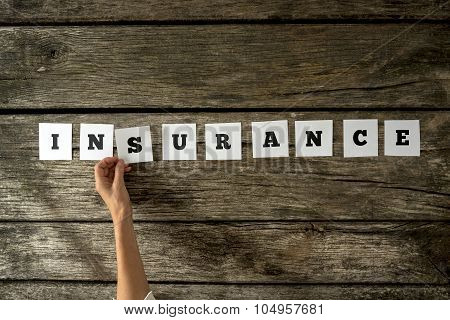 Top View Of Female Insurance Agent Assembling The Word Insurance