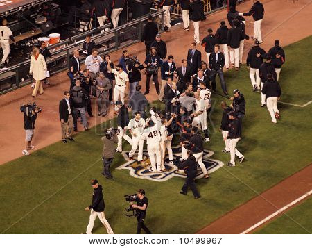 Giants Celebrate Victory Outside Of The Dugout With Cameramen Recording
