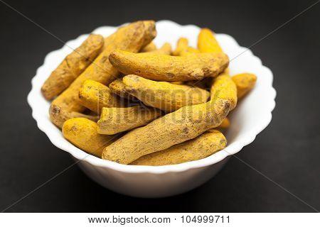 Organic Long Turmeric in white bowl.