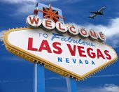 welcome to las vegas sign with plane flying overhead in las vegas *** Note, slight graininess, best at small sizes. poster