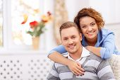 Cheerful loving vivacious young couple embracing and spending agreeable time together poster