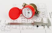 Red water meter with  trammel on draft background poster