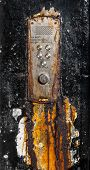 A Rusty Old Buzzer Or Intercom System For Flats In Glasgow Scotland poster