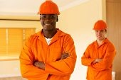 portrait of african workman and co-worker on background poster