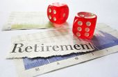 Retirement newspaper headline with dice and stock market graphs poster