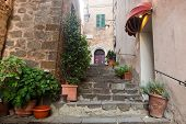 Romantic narrow street and stairs in Montepulciano, Tuscany, Italy. Tuscan architecture poster