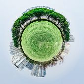Overpopulated urban planet covered in city buildings poster