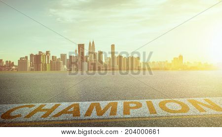 View of the empty asphalt road with champion word and city skyline background . Evening scene .