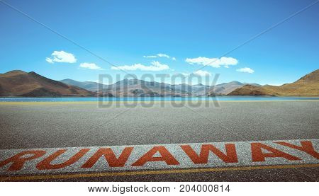 View of the empty asphalt road with runaway word and beautiful mountain landscape . Evening scene .