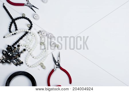 Beads And Tools On A White Background