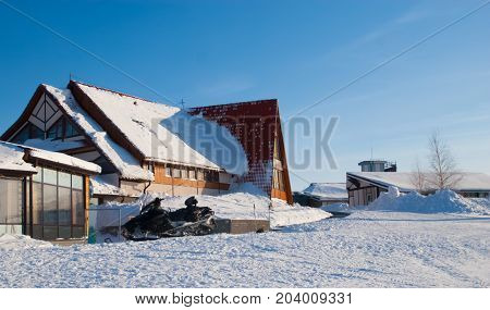Winter house in ski resort on blue sky