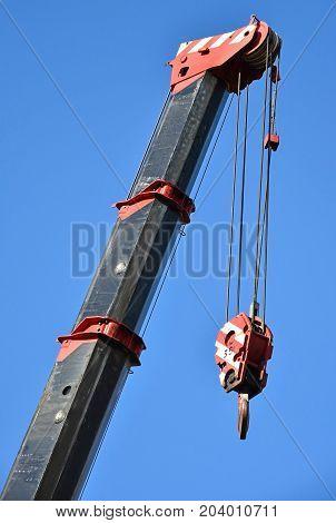 Hook of a large crane against blue sky