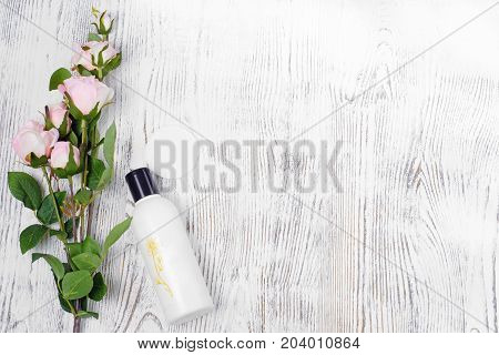 Lotion of cotton wadded pad cotton disk on white wooden background isolation